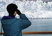 ALA94LS3_14 Ecotourism: UK woman looks through binoculars at water and Margerie Glacier, whale watching area. Glacier Bay, Alaska. Copyright Tropix (Lynn Seldon)