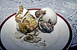 PHL91TX7_11 Local food delicacy: hard boiled duck embryos served on plate. Novices eat them with lights dimmed. Balut, Philippines. Copyright Tropix (V. and M. Birley)