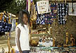 SGL97MF1_03 Wolof tribal girl (13?) with dreadlocks poses by souvenir stall. Senegal. Copyright Tropix (M. Fleetwood)