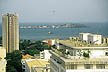 SGL97MF1_22 Commercial & apartment buildings, trees, high rise BCEAO bank? block; ship at sea; Goree Is. beyond. Dakar City, Senegal Copyright Tropix (M. Fleetwood)