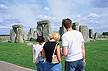 ENG02TX9_16 Young tourist couple look at Stonehenge, read leaflets: prehistoric megalith, druid religion. Wiltshire, S.England. Copyright Tropix (V. and M. Birley)